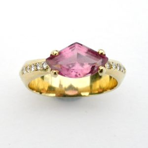 Pale pink tourmaline fancy cut set in 18ct gold with pave diamonds