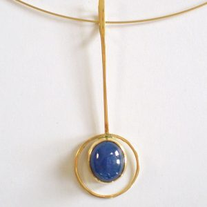 Sapphire cabochon set in 18ct gold pendant on gold cable chain