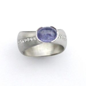 Tanzanite set in 18ct white gold dome ring with pave diamonds