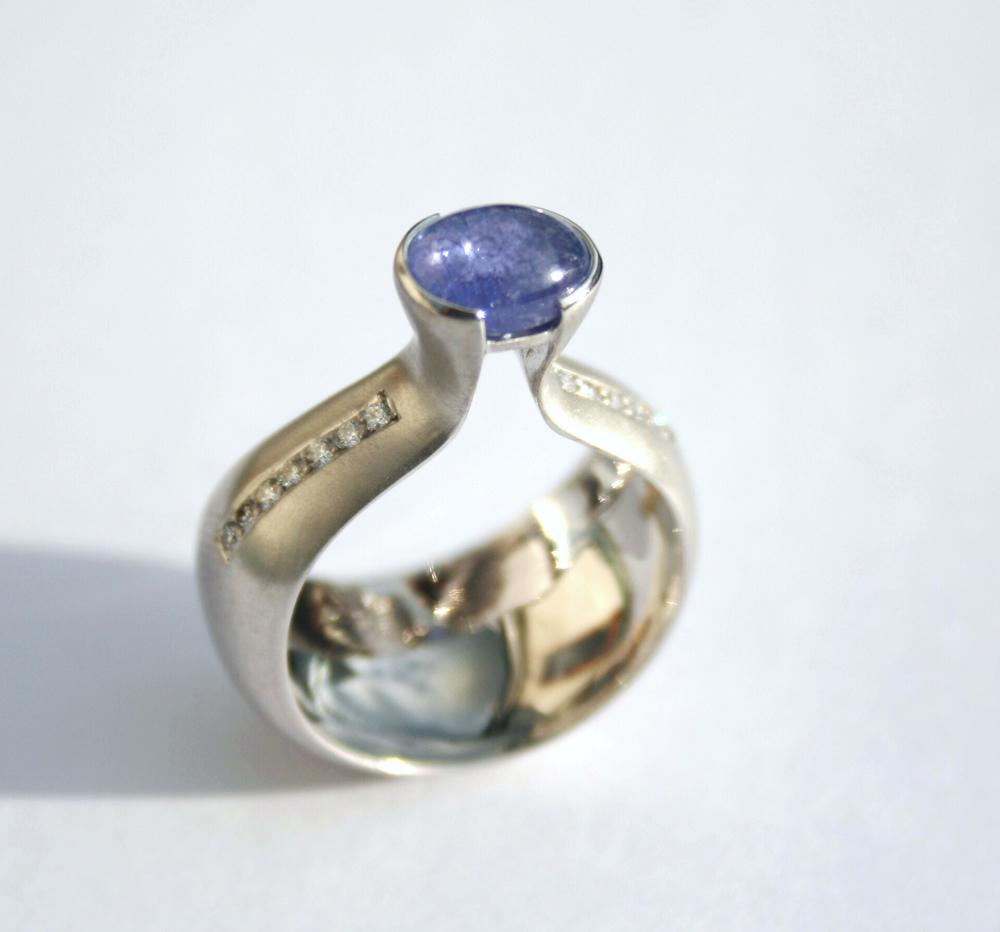 Tanzanite set in 18ct white gold dome ring with pave diamondsv2