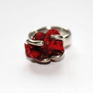 Acrylic set in silver ring