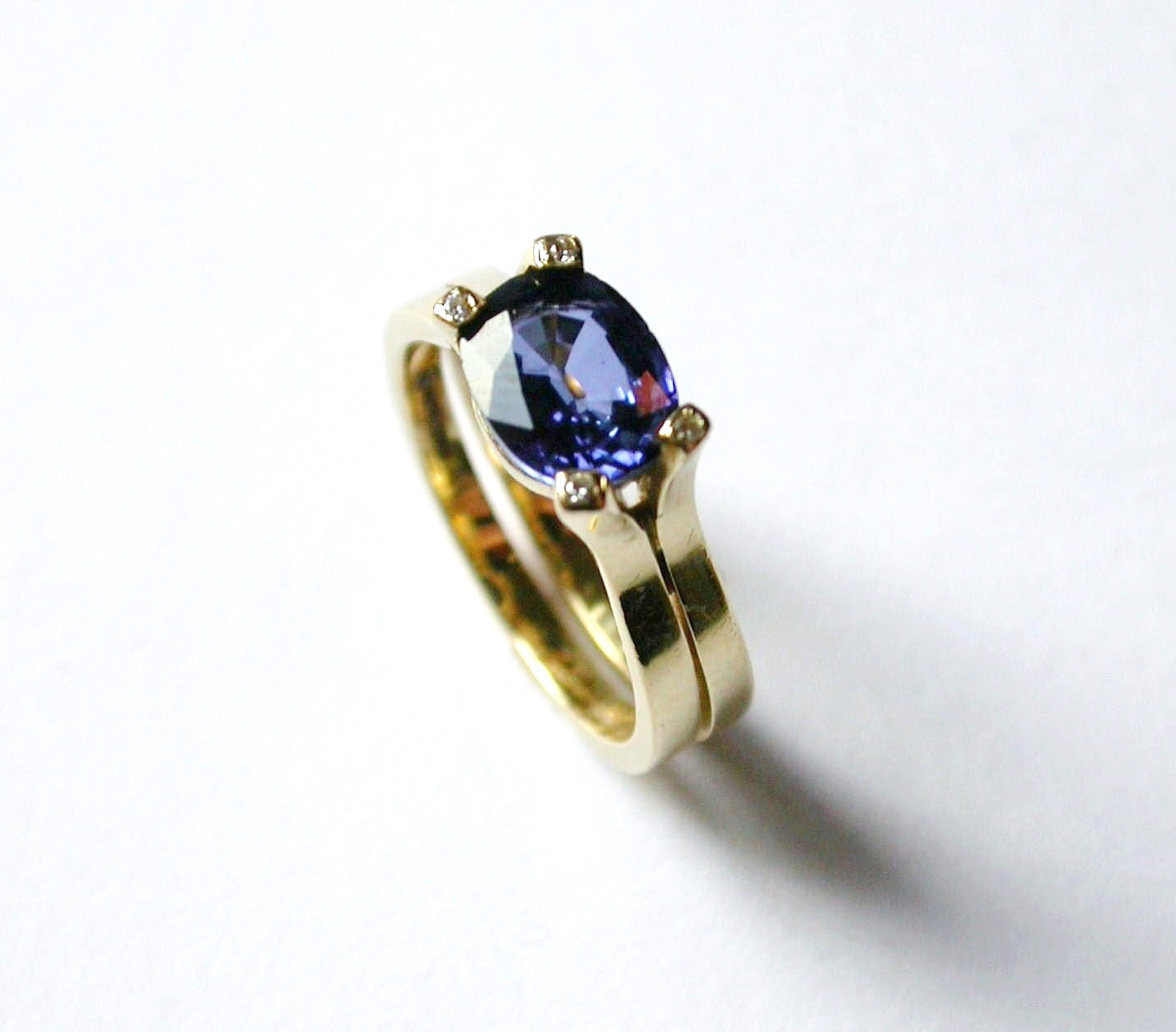 Blue oval cut sapphire and diamond engagement ring 18ct yellow gold