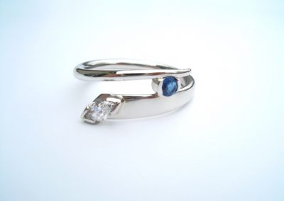 Blue sapphire & marquise diamond set in platinum engagement ring