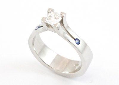 Brilliant cut diamond and sapphires set in palladium engagement ring