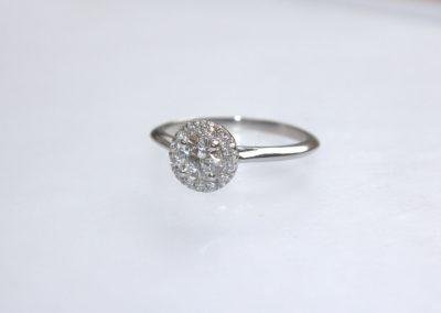 Halo design diamond engagement ring platinum
