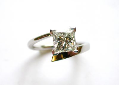 Princess cut diamond set in wrapped style platinum engagement ring