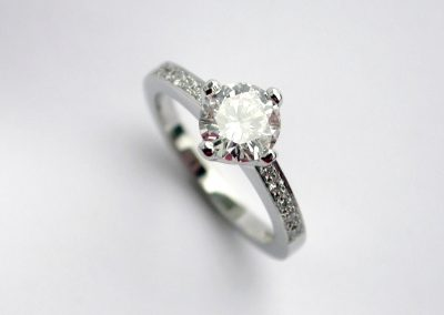 Solitaire and pave diamond engagment ring in platinum classic design