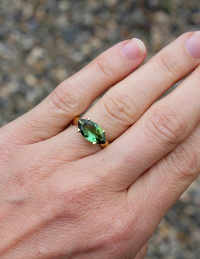 Bespoke 18ct gold ring set with Marquise cut green Tourmaline