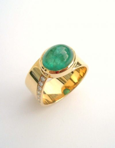 Cabouchon Emerald with diamonds set in 18ct gold ring, bespoke for a 70th birthday present