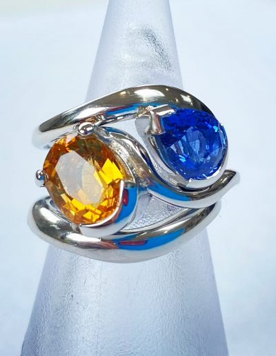 Blue and Warm Yellow Engagement Ring in Platinum