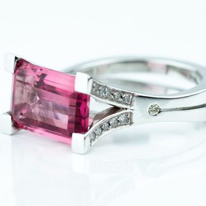 Octagonal cut pink tourmaline set in 18ct white gold with pave diamonds on split shank ring