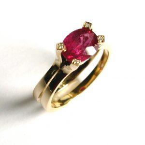 oval cut Burmese ruby set in 18ct gold split shank ring diamonds on claws