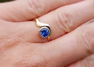 Blue sapphire & diamond wave design engagement ring 18ct gold