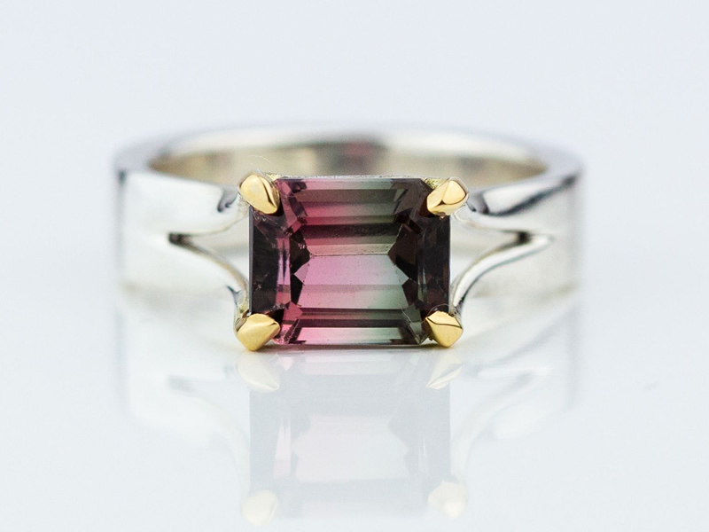 Stunning Bicolour tourmaline, emerald cut set in silver ring with 18ct tiped claws
