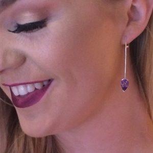 Amethyst pear cut 12x8 set in silver straight hoop earrings on model