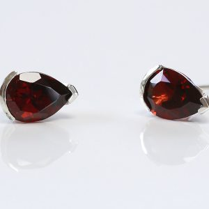 Garnet pear cut 10x7 set in silver stud earrings