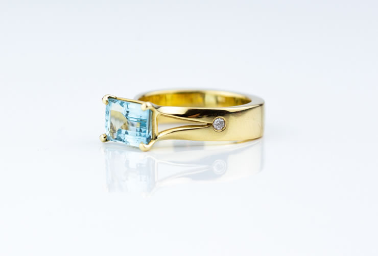 Octagon cut Aquamarine set in 18ct gold ring with 2pts diamonds set in shank