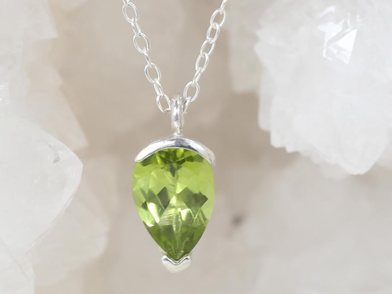 Peridot pear cut 10x7 set in silver pendant on trace chain