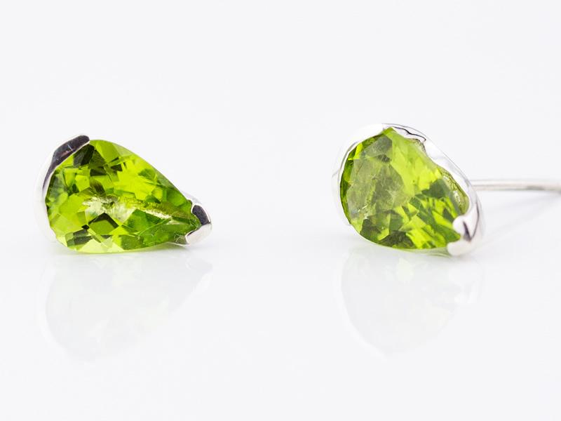 Peridot pear cut 10x7 set in silver stud earrings
