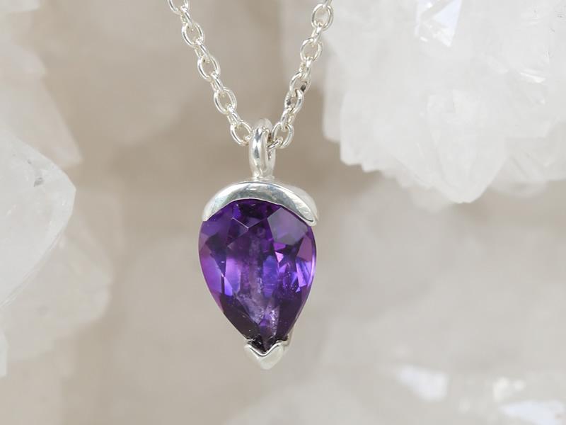 Purple Amethyst pear cut 10x7 set in silver pendant on trace chain