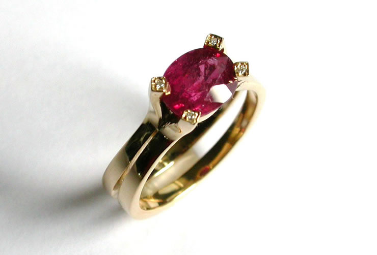 Ruby set in 18ct gold with diamonds