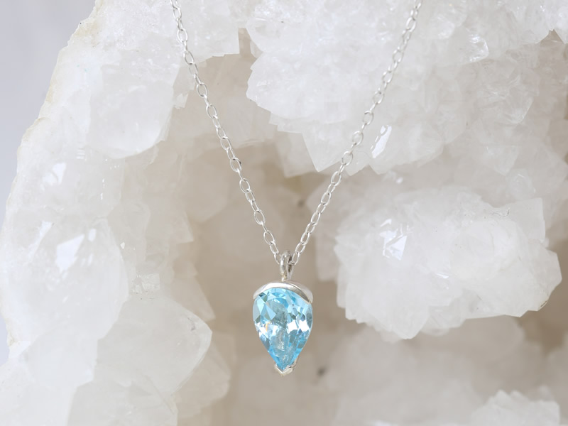 Sky blue topaz pear cut 10x7 set in silver pendant on trace chain